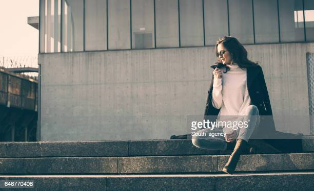 Girl sitting on steps