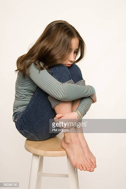 girl (11-12) sitting on stool, studio shot - only girls stock pictures, royalty-free photos & images