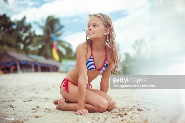 girl sitting on the beach - girl strips stock pictures, royalty-free photos & images