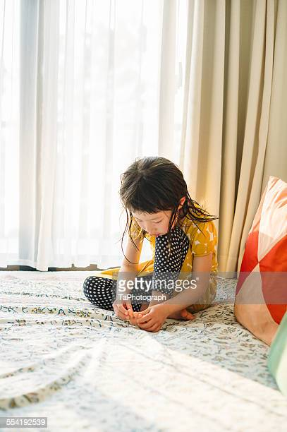 Girl sitting on the bed