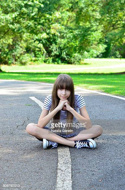 girl sitting on the road - little girls up skirt stock pictures, royalty-free photos & images