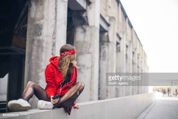 girl sitting on the street - teen pantyhose stock photos and pictures