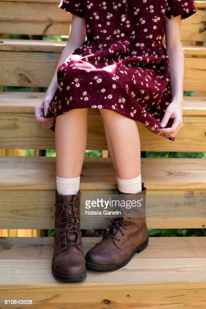 girl sitting on wooden staircase - leather boot stock pictures, royalty-free photos & images