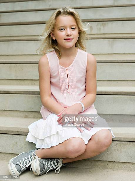 Girl sitting on wooden steps, portrait