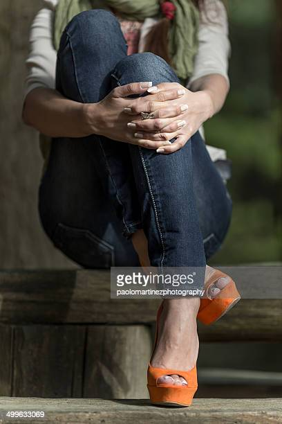 Girl sitting on wooden table outdoor