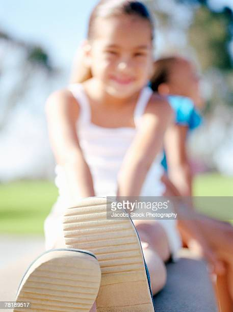 Girl sitting outdoors