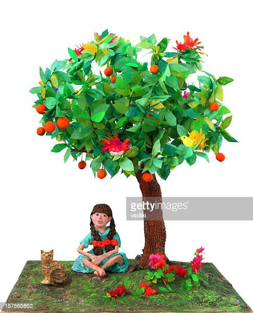 girl sitting under tree - mixed media stock pictures, royalty-free photos & images