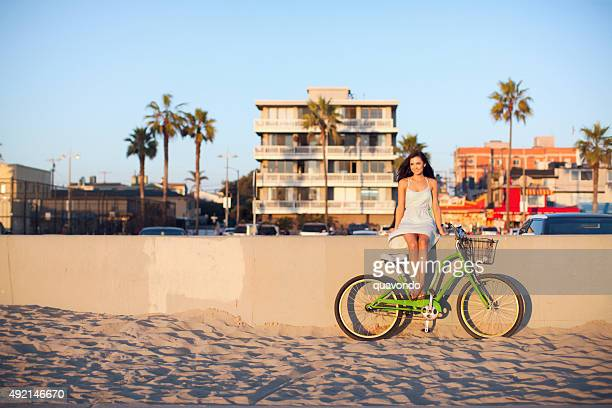Girl Sitting With Bike at Beach