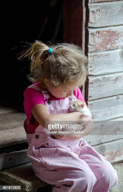 Girl Sitting With Kitten On Steps
