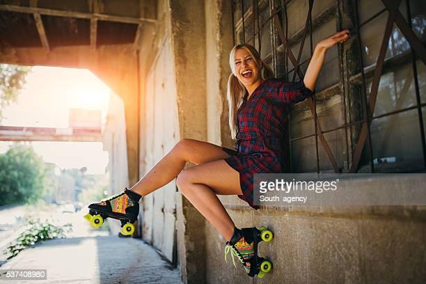 Girl sitting with roller skates