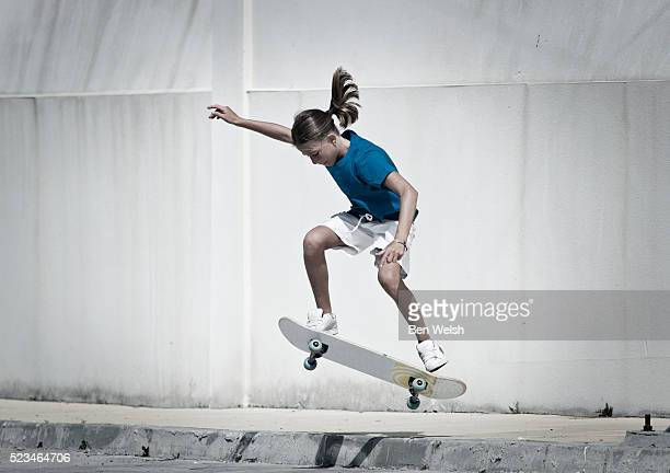girl (13-15) skateboarding - skateboard stock pictures, royalty-free photos & images