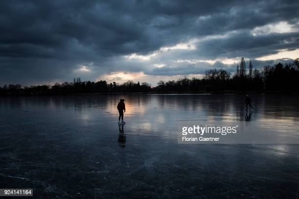 A girl skates on a frozen lake on February 25 2018 in Potsdam Germany