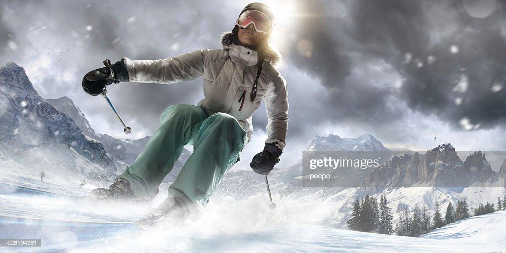 Girl Skiing Fast in Ski Resort : Stock Photo