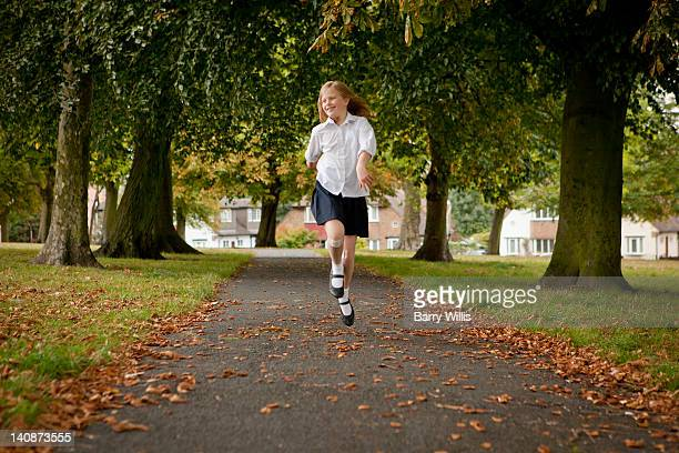 Girl skipping on road in park