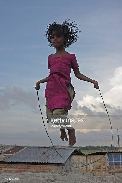 A girl skips at the Kurmitola Bihari Camp in Dhaka Bangladesh August 04 2008