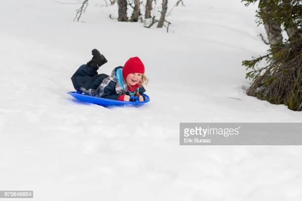 Girl sledging downhill
