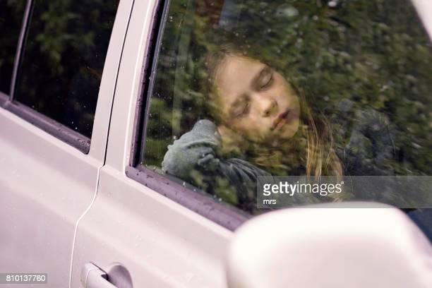 Girl sleeping in a car
