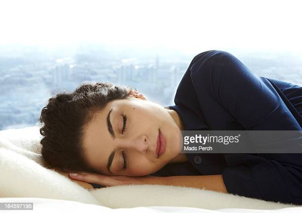 Girl sleeping in bed with city view