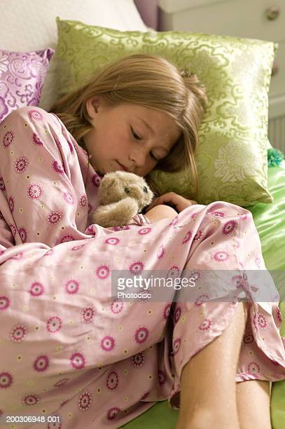 girl (10-11) sleeping in bedroom - 10 11 years stock photos and pictures
