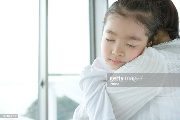 Girl sleeping in grandmother's chest