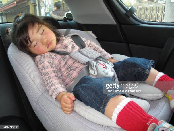 A girl sleeping in the car in Japan