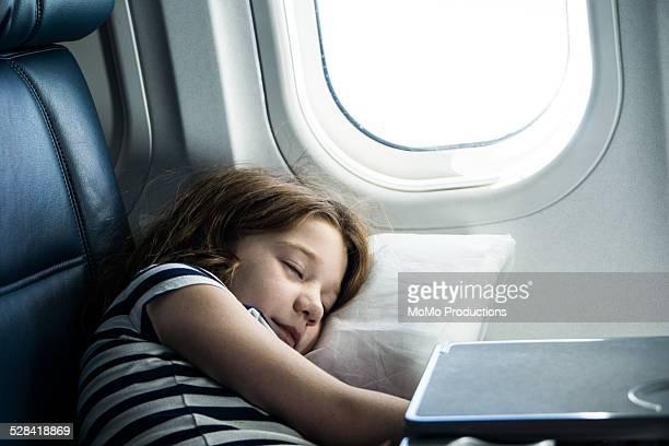 girl (7 yrs) sleeping on airplane