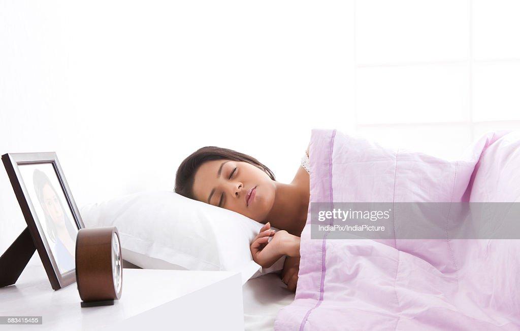 Girl sleeping on bed : Stock Photo