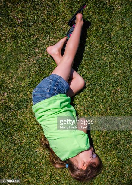 girl sleeping on grass - marty hardin stock photos and pictures