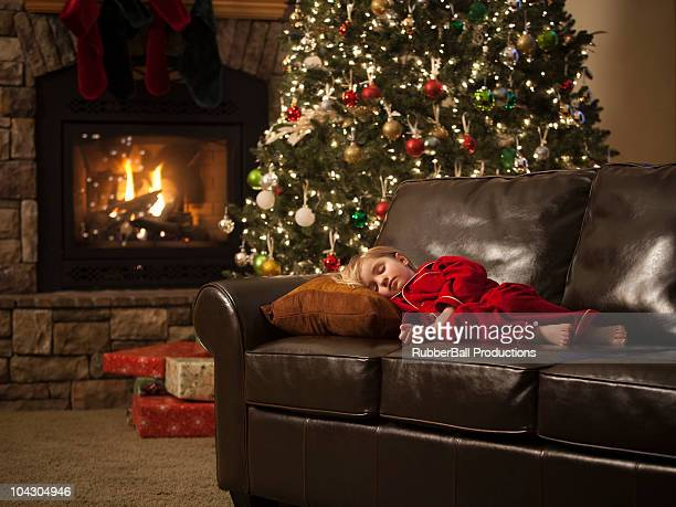 girl sleeping on the couch by the christmas tree - orem utah stock pictures, royalty-free photos & images