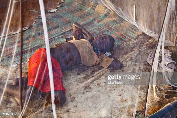 Girl sleeping under mosquito netting