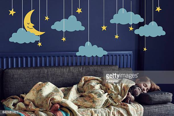 Girl sleeping under the stars and moon