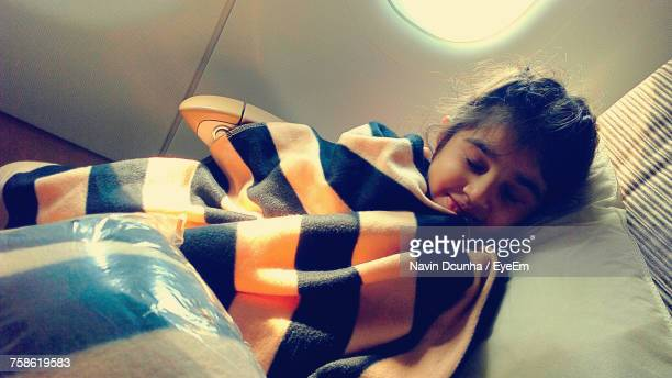 Girl Sleeping With Blanket In Airplane
