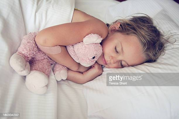 Girl sleeping with stuffed animal