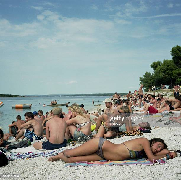 A girl sleeps on the beach at Outlook Festival 2010 in Croatia