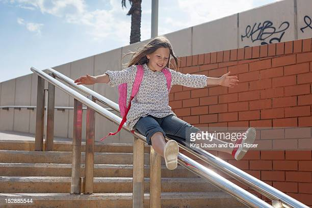 girl sliding down banister on steps - legs apart stock pictures, royalty-free photos & images