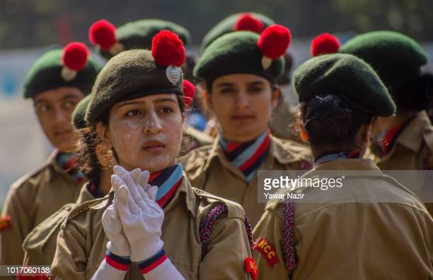 A girl smeared with sunscreen stands with stands with it's contingent before their parade at the Sher i Kashmir stadium where the authorities held...