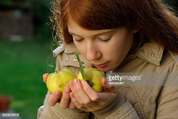 Girl smelling quinces