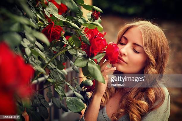 girl smelling roses