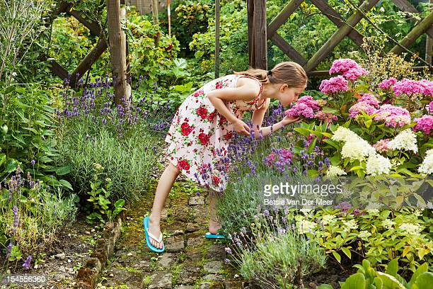 Girl smells hortentia flower in garden