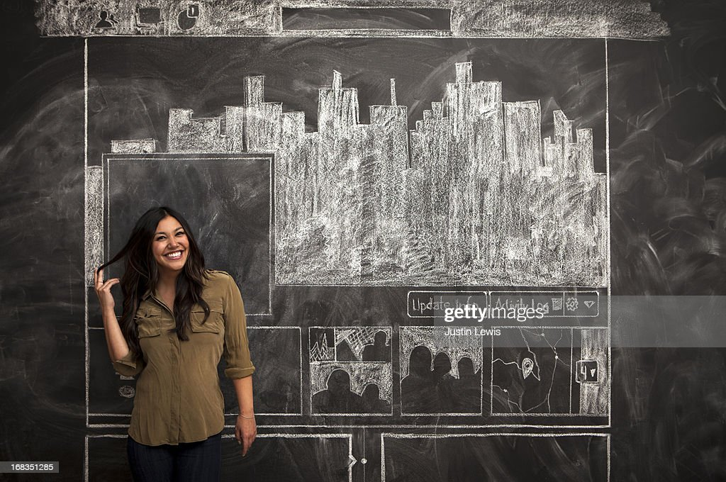 Girl smiles in front of facebook chalkboard : Stock Photo