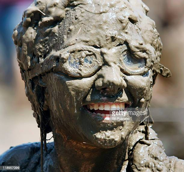 A girl smiles while covered in mud during Wayne County's 2011 Mud Day event at Nankin Mills Park July 12 2011 in Westland Michigan The annual event...