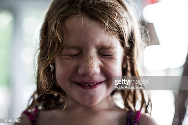 girl (5 yrs) smiling and squinting-portrait