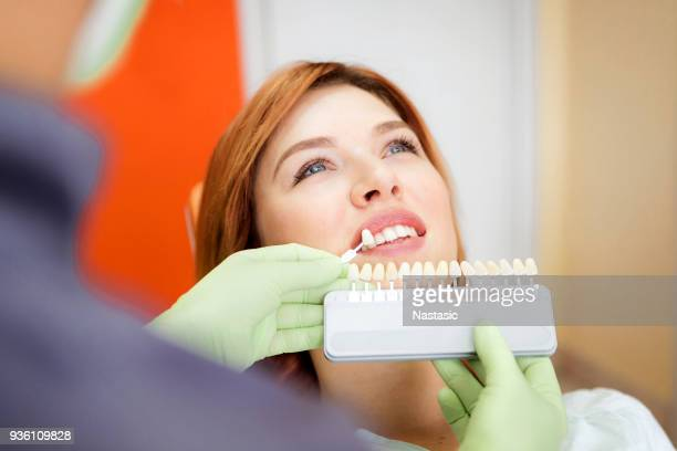 girl smiling at the dentist - implant stock photos and pictures