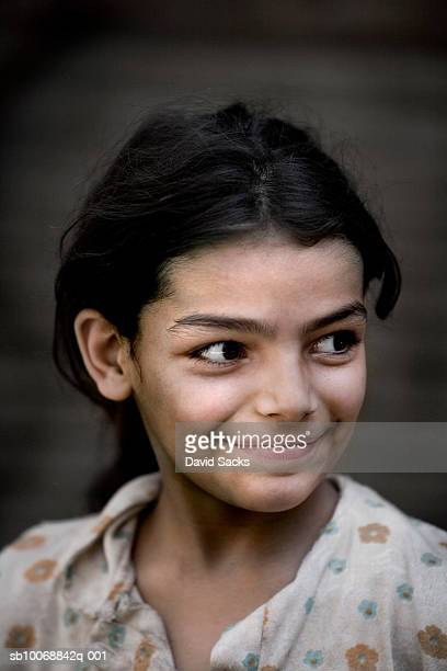 Girl (8-9) smiling, close-up