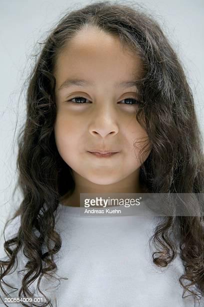 Girl (4-5) smiling, close-up, portrait