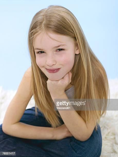 Girl (10-11) smiling, close-up, portrait