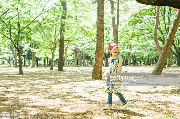 Girl smiling in the forest park