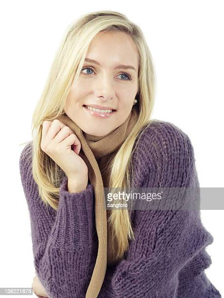 Girl smiling in winter sweater