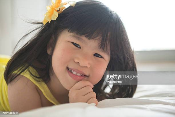 Girl smiling on a bed
