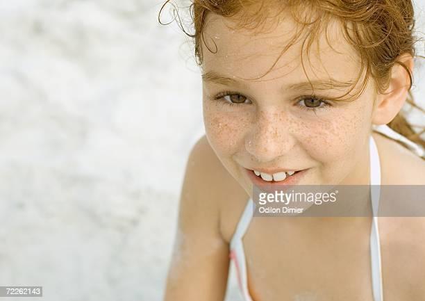Girl smiling on beach, portrait